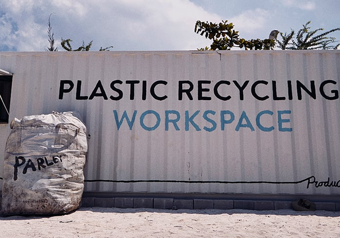 There is a big bag with a Parley logo that is filled with plastic waste