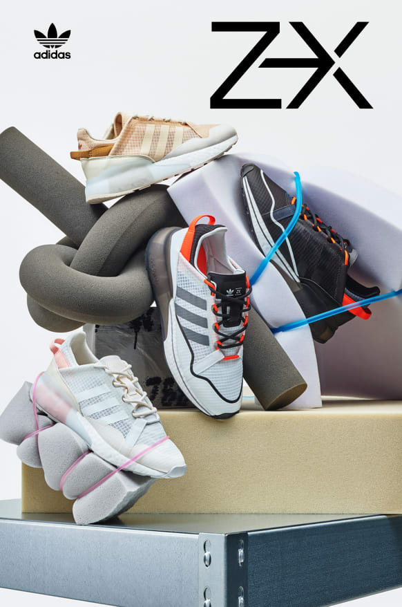 Four ZX 2K BOOST PURE shoes are stacked to show various angles of the silhouette.