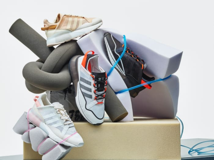 All four ZX 2K BOOST PURE unisex and women's shoes are stacked up.