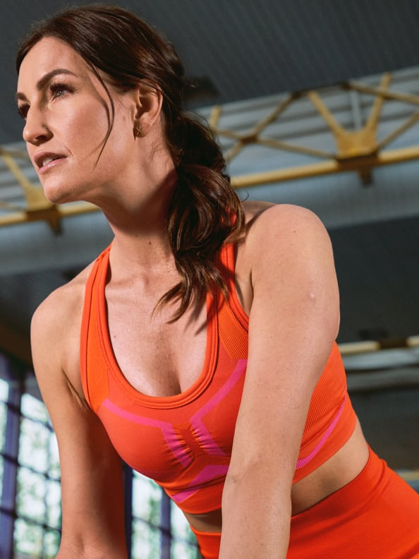 Denise Schindler wears the adidas Formotion Spring/Summer 2021 collection in Solar Red.