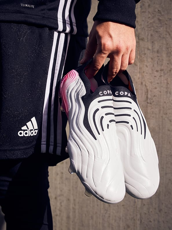 Lifestyle image featuring the Copa Boots.