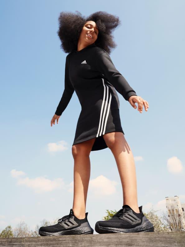 WNBA player Erica Wheeler and English footballer Noni Madueke wear adidas clothing with the iconic three stripes.