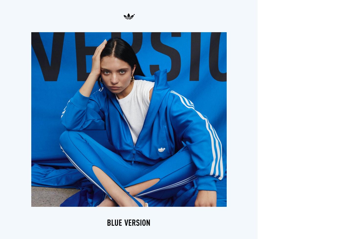 An image of Ganna Bogdan sitting cross-legged sporting the Blue Version Beckenbauer tracksuit in bluebird.