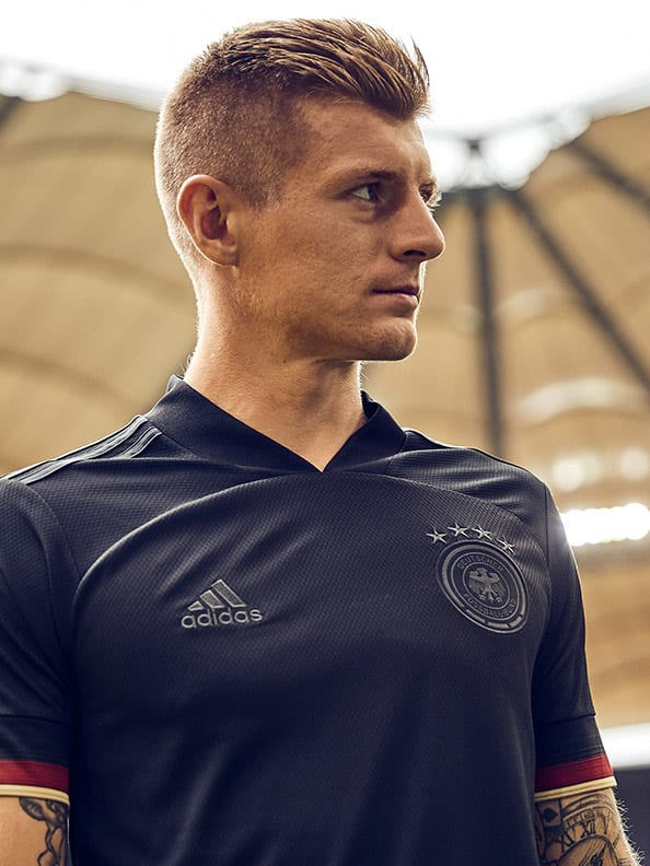 The new Germany Away jersey is shown here. Back in black, standing for confidence and elegance.