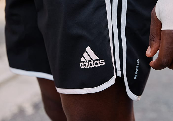 A man is wearing Primeblue shorts